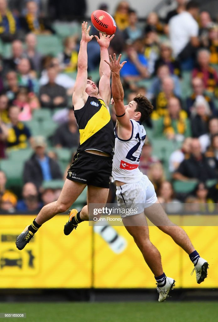 Jack Higgins of the Tigers marks infront of Lachie Neale of the Dockers during the round seven AFL match between the Richmond Tigers and the Fremantle Dockers at Melbourne Cricket Ground on May 6, 2018 in Melbourne, Australia.
