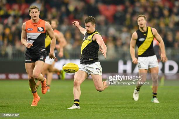 Jack Higgins of the Tigers runs with the ball during the round 17 AFL match between the Greater Western Sydney Giants and the Richmond Tigers at...