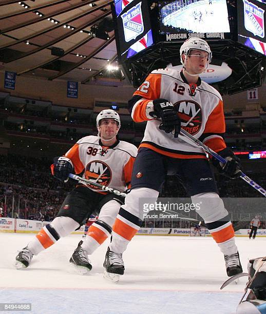Jack Hillen and Josh Bailey of the New York Islanders skates against the New York Rangers on February 18 2009 at Madison Square Garden in New York...