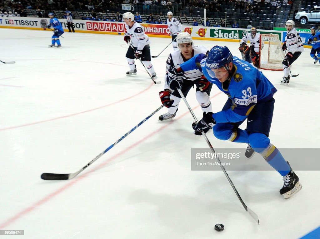 Jack Hillen (R) of United States battles for the puck with Andrei Gavrilin (L) of Kazakhstan during the IIHF World Championship final round match between USA and Kazakhstan at Lanxess Arena on May 15, 2010 in Cologne, Germany.