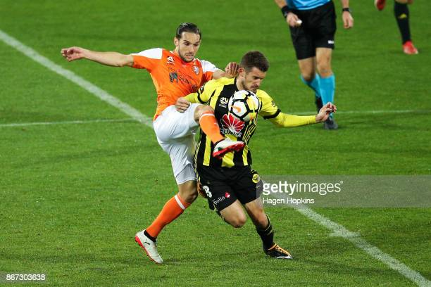 Jack Hingert of Brisbane and Dario Vidosic of the Phoenix compete for the ball during the round four ALeague match between the Wellington Phoenix and...