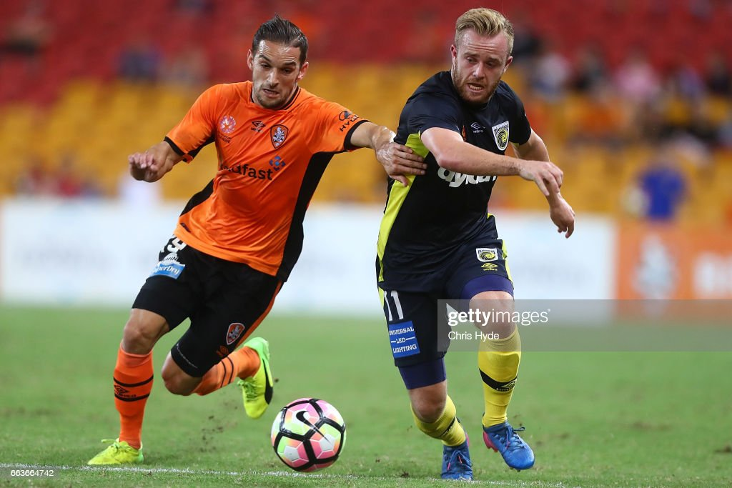 Jack Hingert of the Roar and Connor Pain of the Mariners compete for the ball during the round 25 A-League match between the Brisbane Roar and the Central Coast Mariners at Suncorp Stadium on April 2, 2017 in Brisbane, Australia.