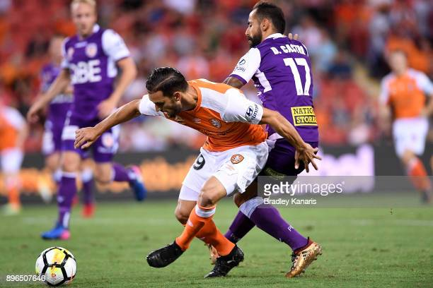 Jack Hingert of the Roar and Diego Castro of the Glory challenge for the ball during the round 11 ALeague match between the Brisbane Roar and the...