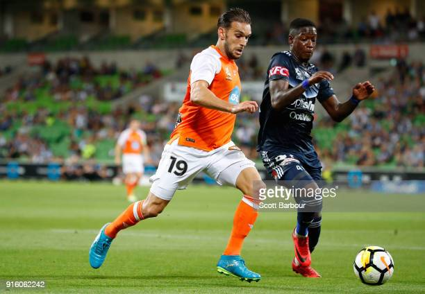 Jack Hingert of the Roar and Leroy George of the Victory compete for the ball during the round 20 ALeague match between the Melbourne Victory and the...