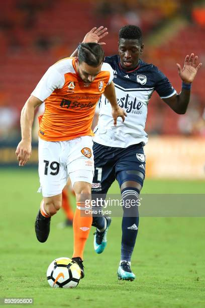 Jack Hingert of the Roar and Leroy George of Vivtory compete for the ball during the round 11 ALeague match between the Brisbane Roar and the...