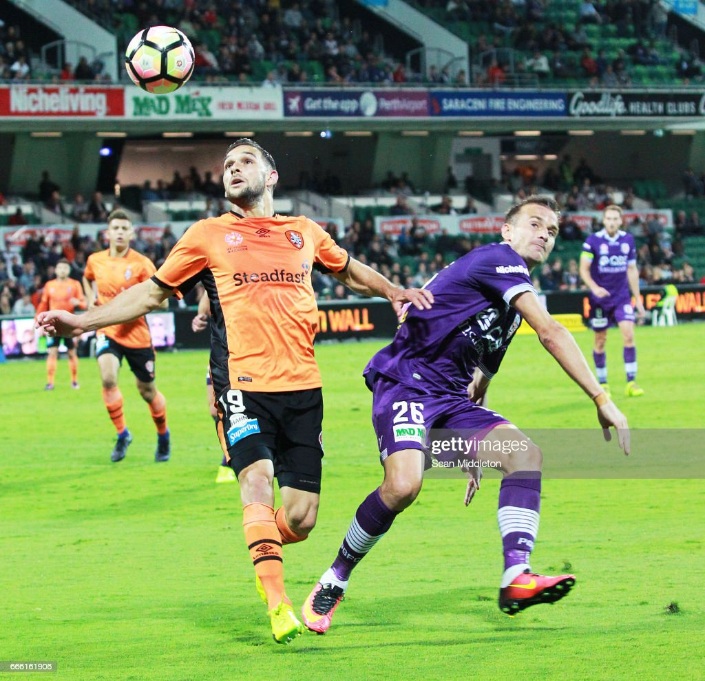 Jack Hingert #19 of the Roar and Lucian Goian #26 of the Glory during the round 26 A-League match between the Perth Glory and Brisbane Roar at nib Stadium on April 8, 2017 in Perth, Australia.