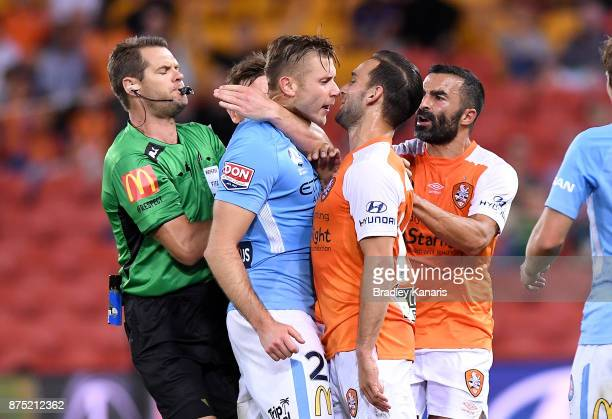 Jack Hingert of the Roar and Marcin Budzinski of Melbourne City face off as tempers flare during the round seven ALeague match between Brisbane Roar...