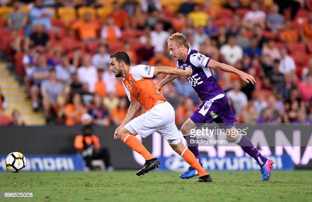 Jack Hingert of the Roar and Mitchell Nichols of the Glory compete for the ball during the round 11 ALeague match between the Brisbane Roar and the...