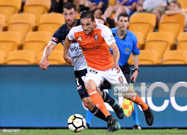 Jack Hingert of the Roar breaks away from the defence during the round 11 ALeague match between the Brisbane Roar and the Melbourne Victory at...