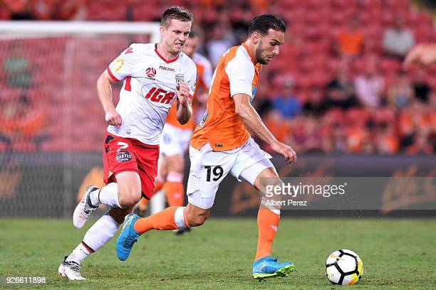 Jack Hingert of the Roar dribbles the ball during the round 22 ALeague match between the Brisbane Roar and Adelaide United at Suncorp Stadium on...