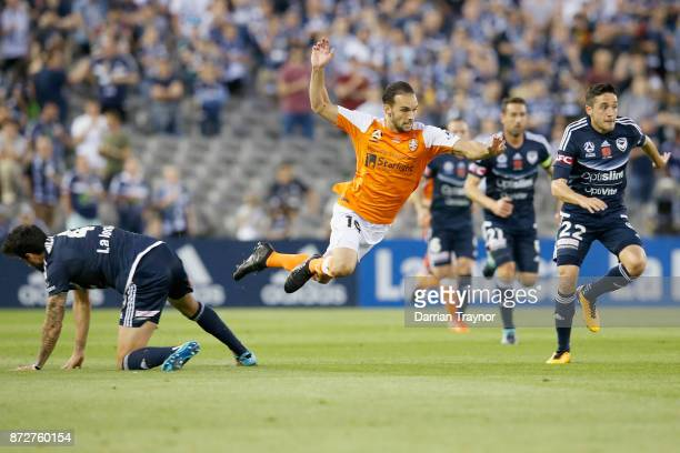 Jack Hingert of the Roar flies through the air during the round six ALeague match between the Melbourne Victory and Brisbane Roar at Etihad Stadium...
