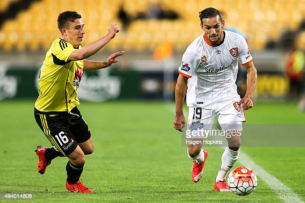 Jack Hingert of the Roar looks to control the ball under pressure from Louis Fenton of the Phoenix during the round three ALeague match between the...