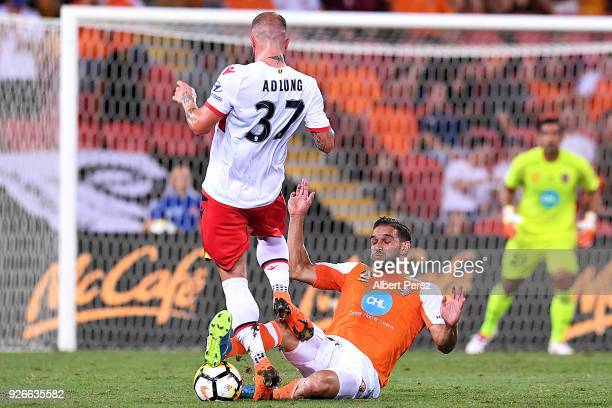 Jack Hingert of the Roar steals the ball from Daniel Adlung of Adelaide during the round 22 ALeague match between the Brisbane Roar and Adelaide...