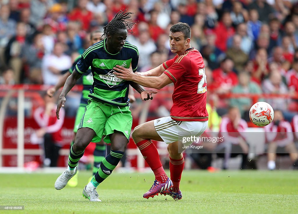 Jack Hobbs of Nottingham Forest battles with Eder of Swansea City during the pre season friendly match between Nottingham Forest and Swansea City at City Ground on July 25, 2015 in Nottingham, England.