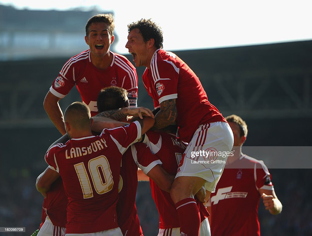 Jack Hobbs of Nottingham Forest is mobbed after scoring the opening goal during the Sky Bet Championship match between Nottingham Forest and Derby County at City Ground on September 28, 2013 in Nottingham, England,