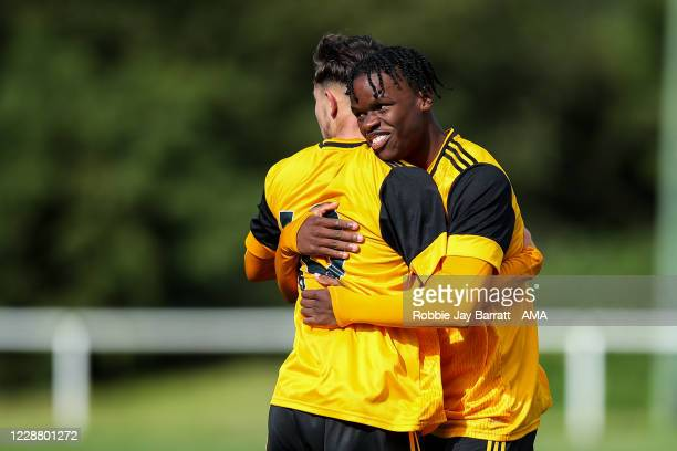 Jack Hodnett of Wolverhampton Wanderers U18 scores a goal to make it 2-2 with Dexter Lambikisa of Wolverhampton Wanderers U18 during the Under 18s...
