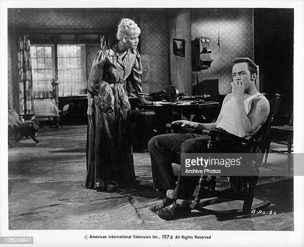 Jack Holden in chair in a scene from the film 'Bonnie Parker's Story', 1958.