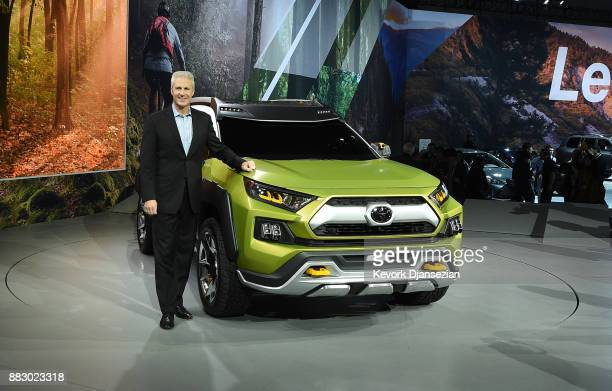 Jack Hollis Group Vice President and General Manager Toyota Division poses with the Toyota Adventure Concept after introducing it during the auto...