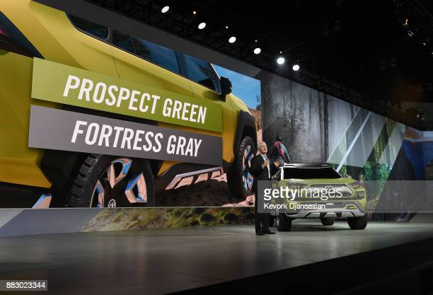 Jack Hollis Group Vice President and General Manager Toyota Division poses introduces the Toyota Adventure Concept during the auto trade show...
