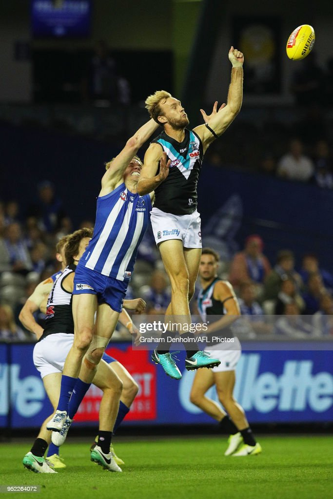 Jack Hombsch of the Power (R) competes in the air with Ben Brown of the Kangaroos during the round six AFL match between the North Melbourne Kangaroos and Port Adelaide Power at Etihad Stadium on April 28, 2018 in Melbourne, Australia.