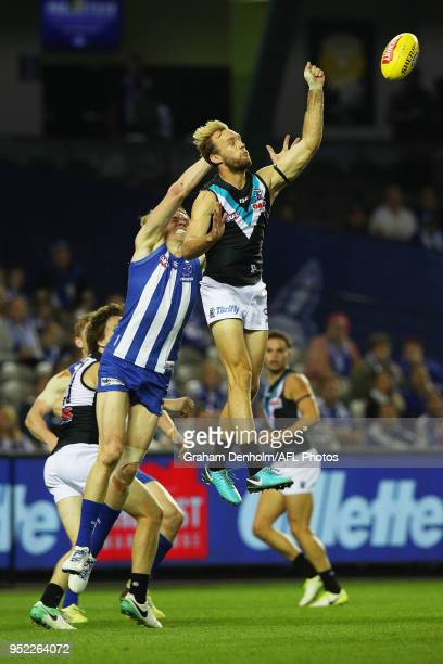 Jack Hombsch of the Power competes in the air with Ben Brown of the Kangaroos during the round six AFL match between the North Melbourne Kangaroos...