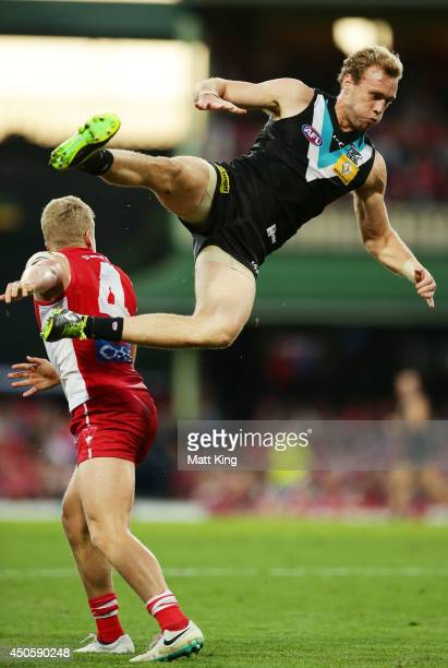 Jack Hombsch of the Power jumps high for the ball during the round 13 AFL match between the Sydney Swans and the Port Adelaide Power at Sydney...