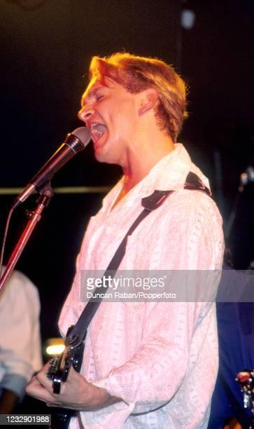 Jack Hues of British New Wave group Wang Chung, performing on stage circa 1986.