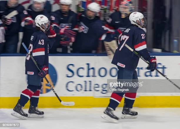 Jack Hughes and DJ King of the USA Nationals pounds gloves with teammates on the bench after a goal against the Czech Nationals during the 2018...