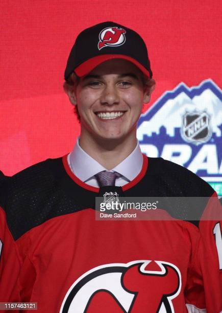 Jack Hughes first overall pick by the New Jersey Devils poses for a portrait onstage during the first round of the 2019 NHL Draft at Rogers Arena on...
