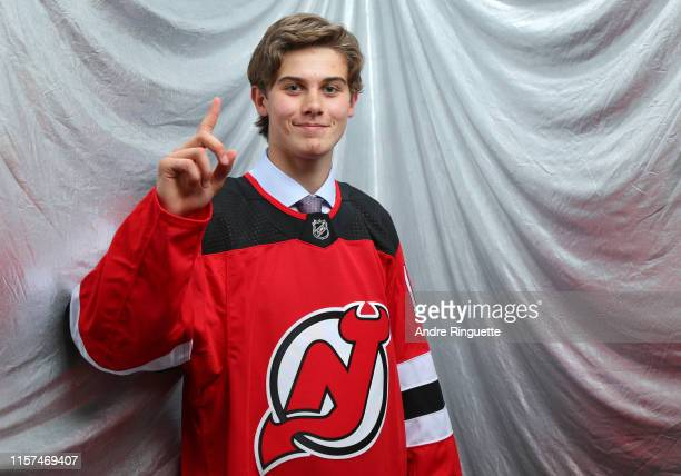 Jack Hughes first overall pick by the New Jersey Devils poses for a portrait during the first round of the 2019 NHL Draft at Rogers Arena on June 21...