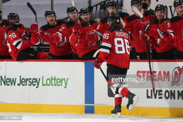 Jack Hughes of the New Jersey Devils celebrates after scoring a goal in the first period against the Pittsburgh Penguins at The Prudential Center on...