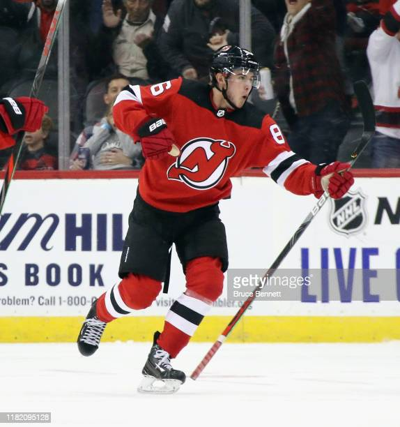 Jack Hughes of the New Jersey Devils celebrates his first NHL goal as he scores at 1408 of the first period on the powerplay against the Vancouver...