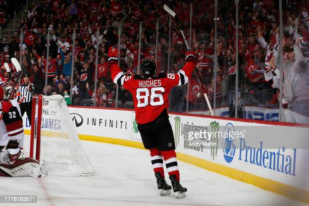 Jack Hughes of the New Jersey Devils celebrates his first period goal during the game against the Arizona Coyotes at the Prudential Center on October...