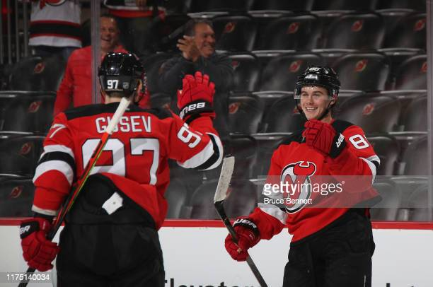 Jack Hughes of the New Jersey Devils celebrates his game winning goal at 41 seconds of overtime on a pass from Nikita Gusev against the Boston Bruins...