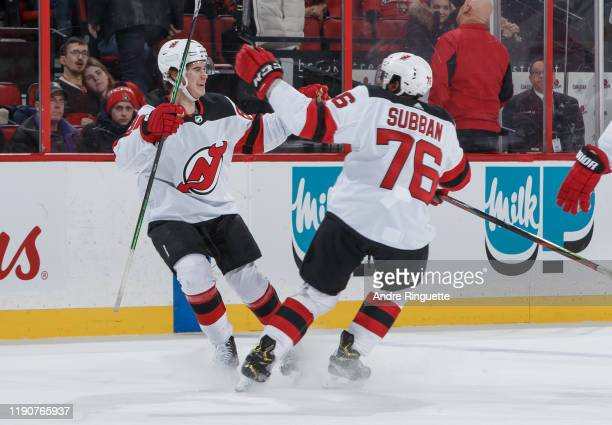 Jack Hughes of the New Jersey Devils celebrates his game-winning overtime goal against the Ottawa Senators with teammate P.K. Subban at Canadian Tire...