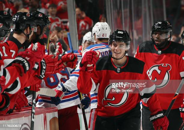 Jack Hughes of the New Jersey Devils celebrates his goal against the New York Rangers at 34 seconds of the first period at the Prudential Center on...