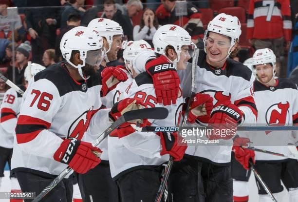 Jack Hughes of the New Jersey Devils celebrates his shootout goal against the Ottawa Senators with teammates P.K. Subban and John Hayden at Canadian...