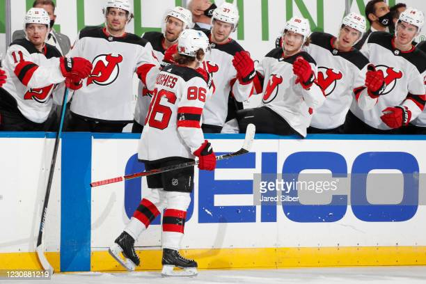 Jack Hughes of the New Jersey Devils celebrates with teammates after scoring a goal in the second period against the New York Rangers at Madison...
