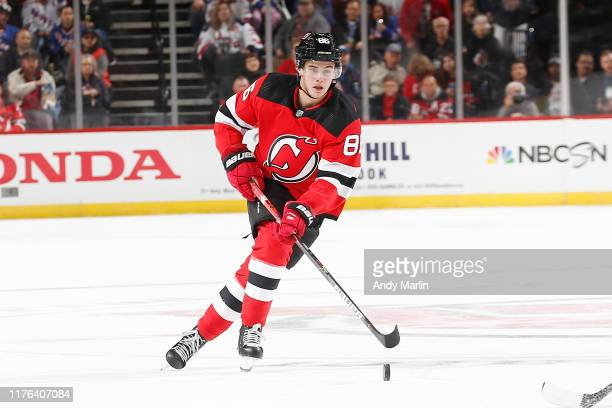 Jack Hughes of the New Jersey Devils plays the puck during the game against the New York Rangers on October 17 2019 at Prudential Center in Newark...