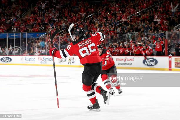 Jack Hughes of the New Jersey Devils reacts after scoring his first career NHL goal in the first period against the Vancouver Canucks at the...
