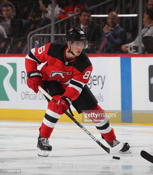 Jack Hughes of the New Jersey Devils skates against the Boston Bruins during preseason action at the Prudential Center on September 16 2019 in Newark...