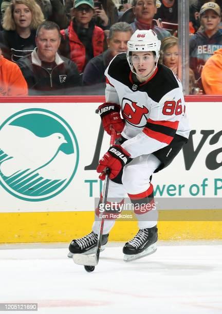 Jack Hughes of the New Jersey Devils skates the puck against the Philadelphia Flyers on February 6, 2020 at the Wells Fargo Center in Philadelphia,...