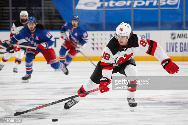 Jack Hughes of the New Jersey Devils skates with the puck against the New York Rangers at Madison Square Garden on January 19, 2021 in New York City.