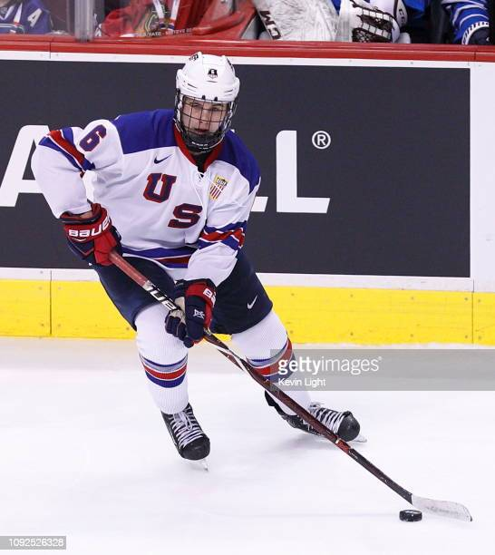 Jack Hughes of the United States skates with the puck against Finland during a gold medal game at the IIHF World Junior Championships at Rogers Arena...