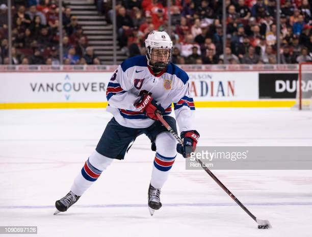 Jack Hughes of the United States skates with the puck in Gold Medal hockey action of the 2019 IIHF World Junior Championship against Finland on...