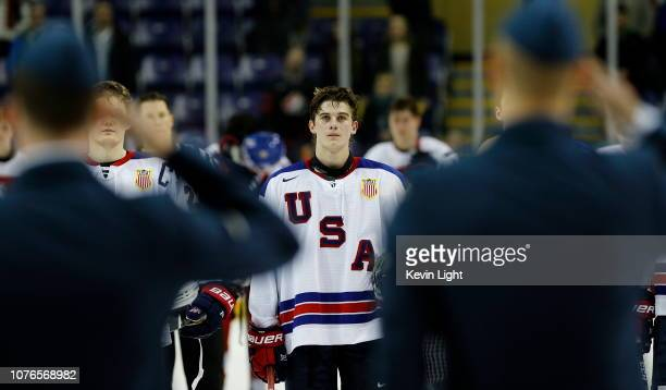 Jack Hughes of the United States stands on the blue line as the American flag is raised following a 31 quarterfinal game victory versus the Czech...