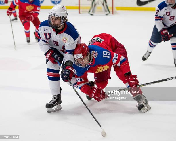 Jack Hughes of the USA Nationals battles for position with Vasili Podkolzin of the Russian Nationals during the 2018 Under18 Five Nations Tournament...