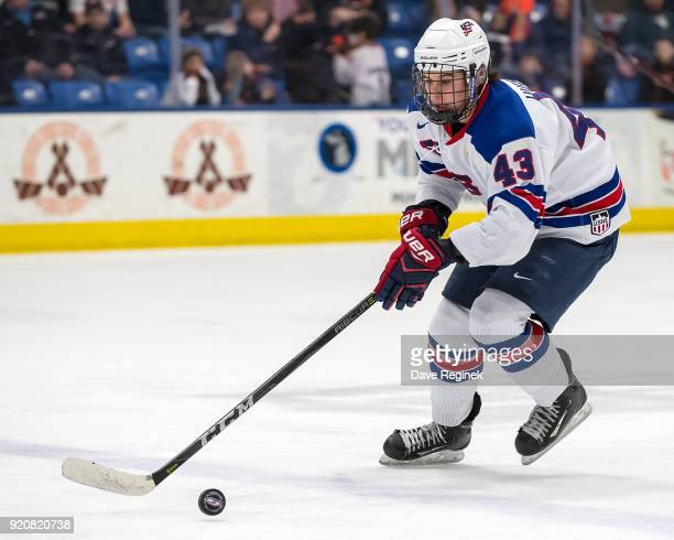 Jack Hughes of the USA Nationals skates up ice with the puck against the Russian Nationals during the 2018 Under18 Five Nations Tournament game at...