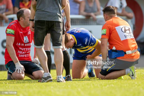 Jack Hughes of Warrington Wolves is treated on the field by medical staff after injuring a testicle it was later revealed he carried on playing after...
