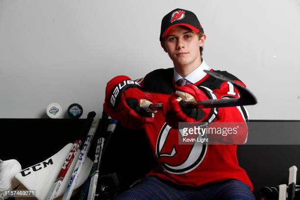 Jack Hughes poses for a portrait after being selected first overall by the New Jersey Devils during the first round of the 2019 NHL Draft at Rogers...